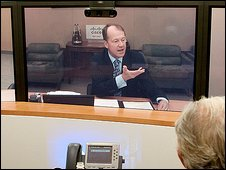 John Chambers at a telepresence conference
