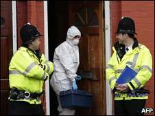 Police officers at raided property