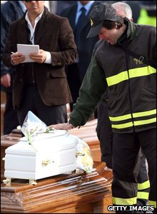 A rescue worker mourns earthquake victims near L'Aquila, Italy, 10 April 2009