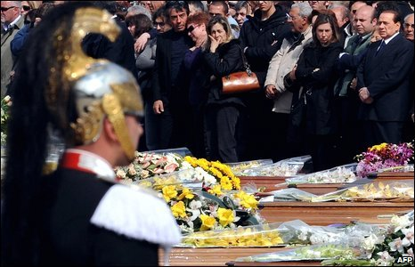Silvio Berlusconi, right, with mourners at the funeral for quake victims in L'Aquila, Italy, 10 April 2009