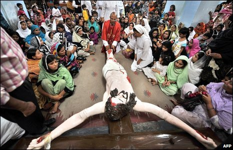 Pakistani Christians gather around a scene depicting the crucifixion of Jesus Christ at a Good Friday service in Lahore
