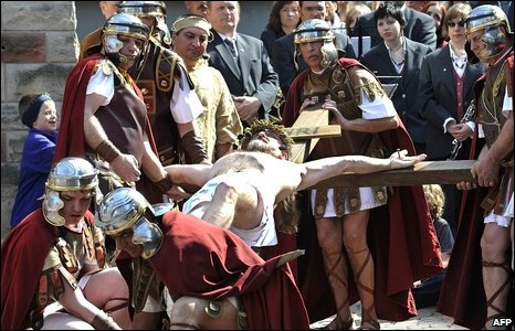 Lay actors perform at a Good Friday procession in Bensheim, Germany