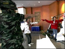 Pro-government supporters break into the summit venue in Pattaya, 11 April.