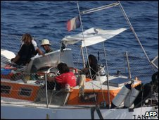 Florent Lemacon (L) and pirates on board the Tanit on 10 April