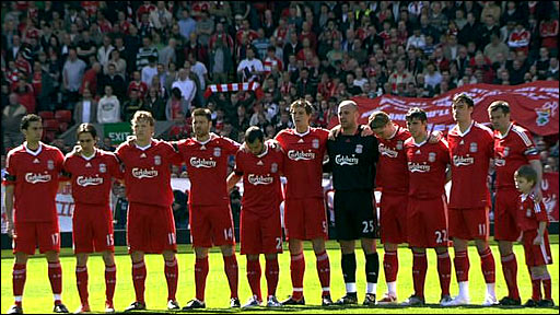 The Liverpool team link arms for a minute's silence