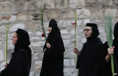Orthodox Christian nuns in a procession in Jerusalem before Palm Sunday