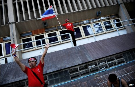 Protesters inside the compound of the interior ministry after storming it, in Bangkok on April 12