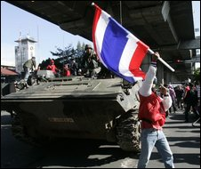 Demonstrators capture a Thai army tank in Bangkok