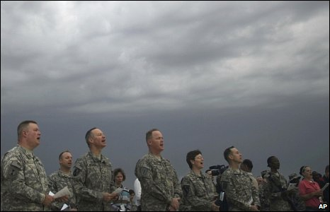 US army soldiers sing hymns during Easter sunrise service in Camp Liberty, Baghdad, Iraq