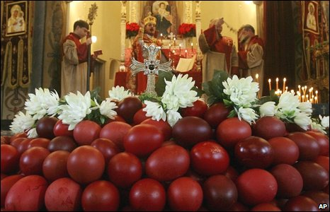 Armenian Orthodox priests in background consecrate hundreds of red eggs at an Easter mass in Varna, north-east of Sofia