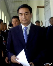 Mr Abhisit arrives for a meeting before declaring a state of emergency at Interior Ministry in Bangkok, April 12