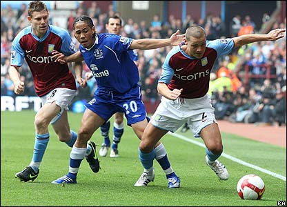 Young and Pienaar contest possession at Villa Park