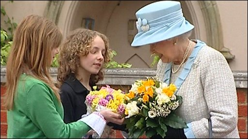 The Queen accepts flowers after an Easter service