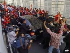Protesters surround car thought to be carrying the prime minister