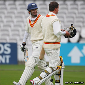 Rob Key (right) walks off to be replaced by Michael Vaughan (left)