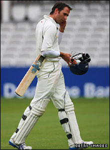 Michael Vaughan walks off after his dismissal