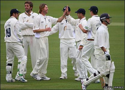 Callum Thorp (centre) celebrates with his Durham team-mates as James Foster (right) is dismissed
