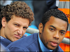 Robinho (R) and his compatriot Elano began City's game against Fulham on the bench