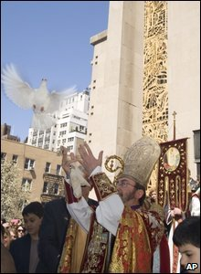 Archbishop Khajag Barsamian of the Armenian Church of America releases a dove in New York