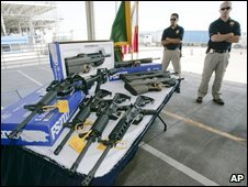 US border guards in San Diego display guns seized on the Mexican border, 1 April