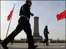 Chinese police patrol on Tiananmen Square, Beijing, China, Mar 09