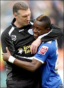 Nigel Pearson (left) and Max-Alain Gradel enjoy the win over Leeds
