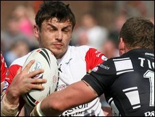 Jon Wilkin is tackled by Danny Tickle