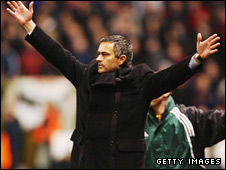 Mourinho celebrates after seeing his side knock out United in 2004