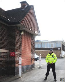 Policeman stands guard at Iona School