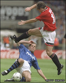 Joe Parkinson tackles Mark Hughes
