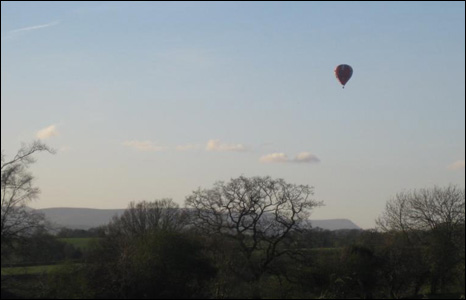 Melanie Millington took this picture of a hot air balloon from her house in about two miles north of Raglan in Monmouthshire.