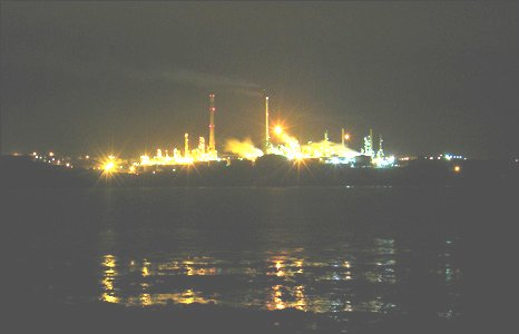 An atmospheric picture of the Texaco oil refinery across the water from Angle in Pembrokeshire (Ben Rees).