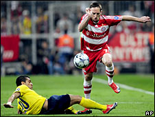 Franck Ribery skips past Daniel Alves