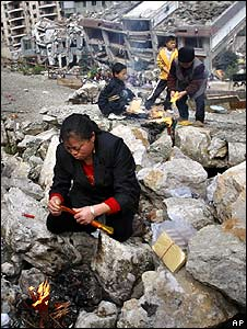 Mourners attend a memorial service for quake victims in Beichuan, Sichuan province