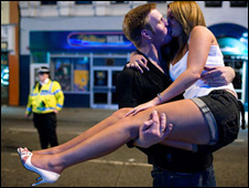 This couple posed for a kiss in the street while  Maciej Dakowicz was taking photos