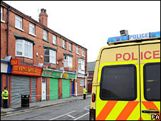Police outside one of the raided properties
