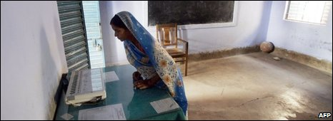An Indian voter watches the Electronic Voting Machine in Koderma