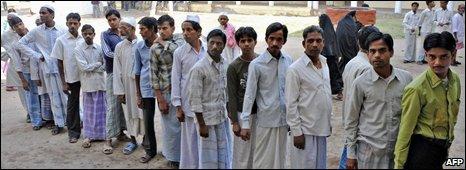 Indian voters queue to cast their vote in Varanasi