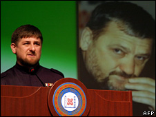 Ramzan Kadyrov speaks in front of a picture of his father, Akhmad Kadyrov (23 March 2009)