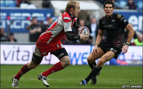 Olly Morgan takes on James Hook of Ospreys in the EDF Cup semi-final