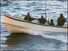 A group of Somalian pirates on their launch
