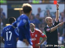 Cahil (left) is sent off by Mike Riley (right)