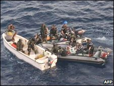 A picture released by the French Army shows French soldiers intercepting pirates off the coast of Kenya, 15 April 2009