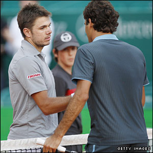 Stanislas Wawrinka (left) shakes hands with Roger Federer