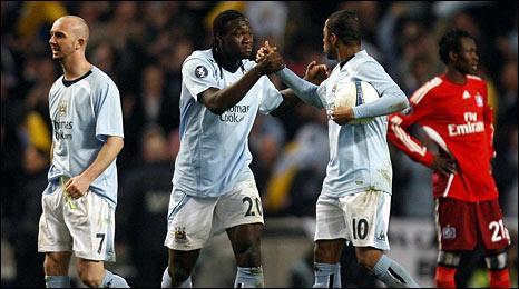 Caceido (second left) celebrates scoring