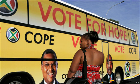 A bus on the election trail from The Congress of the People, COPE, drives past in a street at Khayelitsha, South Africa, Tuesday, April 14, 2009