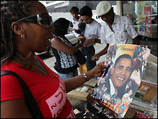Woman looks at Obama merchandise in Port of Spain, Trinidad and Tobago - 16/4/2009