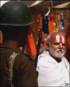 File image of a soldier and a hindu holy man at Ayodhya in March 2002