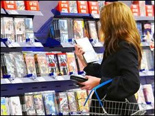 Tesco customer browsing DVDs