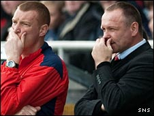 Brian Rice and John Hughes look on with concern